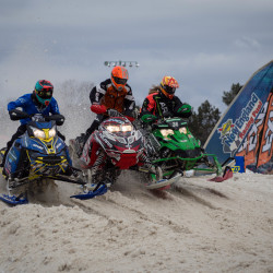 Competitors battle for position in a race during the East Coast Snocross tour on Saturday at Bass Park in Bangor. The event returns to Bangor on Jan. 28 and 29.