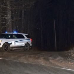 A Lincoln County Sheriff's Office vehicle waits at the end of River Bend Road in Waldoboro shortly after 2 a.m. Sunday. Deputies closed the road off after a police-involved shooting.