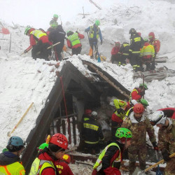 Rescue workers search around the Hotel Rigopiano in Farindola, central Italy, hit by an avalanche, in this undated picture released Jan. 22, 2017, provided by Alpine and Speleological Rescue Team.