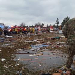 A U.S. Air Force airman surveys debris covering an area of the Sunshine Acres neighborhood after a tornado struck Adel, Georgia, Jan. 22, 2017.