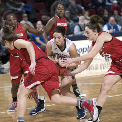 The University of Maine's Laia Sole (center) scrambles for the ball with Hartford's Darby Lee (right) and Lyndsey Abed (foreground left) during the game at the Cross Insurance Center in Bangor last week.