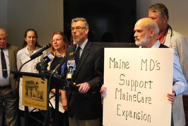 Andrew MacLean, deputy executive vice president of the Maine Medical Association, voices his organization's support for Medicaid expansion at the State House Welcome Center in Augusta, Jan. 23, 2014.