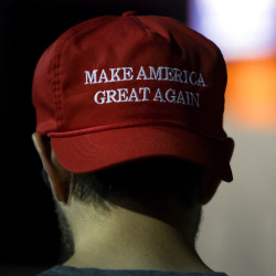 "A Donald Trump supporter wears a ""Make America Great Again"" hat while waiting for a campaign rally to start at the Cross Insurance Center in Bangor, May 29, 2016."