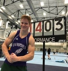Hampden Academy senior Johann Bradley celebrates after breaking the Eastern Maine Indoor Track League record in the pole vault, clearing 14 feet, 3.25 inches, on Saturday at the University of Maine's New Balance Field House in Orono.