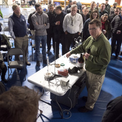 Charles Luman of the FBI talks about a mock laboratory during training for emergency responders to help identify meth labs and other setups for producing poisonous or explosive chemicals on Tuesday at Eastern Maine Community College in Bangor.