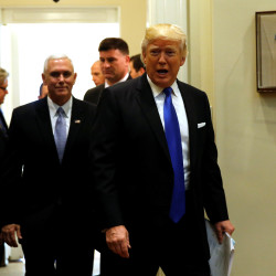 President Donald Trump and Vice President Mike Pence arrive for a meeting with U.S. auto industry CEOs at the White House in Washington on Tuesday.