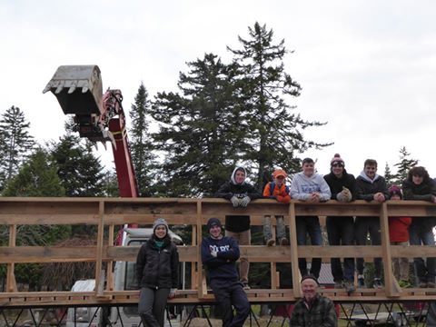 Greenville Consolidated School students work on a 31-foot, cross-country ski bridge for the community group Friends of Squaw Mountain. Student Anthony Mason organized all volunteers and contractors for the project while earning his Eagle Scout ranking.