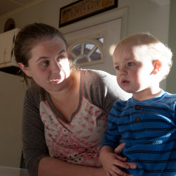 Kayla Doherty, 23, with her 17-month-old son Blake Doherty at her mother's Pittsfield home.