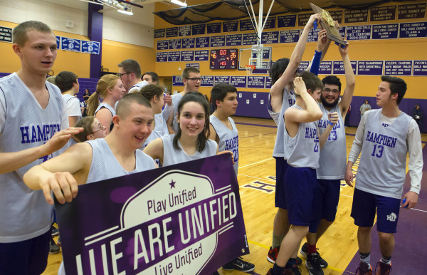 Hampden Academy players celebrate after defeating Lewiston during the unified basketball North regional championship game in Hampden in this March 2016 file photo.