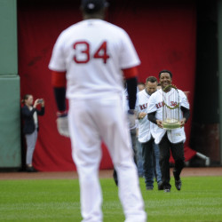 Former Boston Red Sox pitcher Pedro Martinez walks onto the field as part of pre game ceremonies for designated hitter David Ortiz (34) prior to a game against the Toronto Blue Jays at Fenway Park in October 2016.