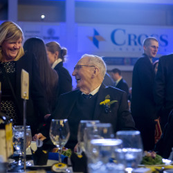 Woodrow Cross (center) laughs with Donna Power during the Bangor Region Chamber of Commerce annual dinner at the Cross Insurance Center in Bangor Friday. Cross, a Bangor region volunteer for many years, was honored with the Norbert X. Dowd Award.