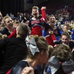 Central cheerleaders celebrate after placing first during the regional Class C North cheerleading competition at the Cross Insurance Center in Bangor Saturday. Central placed first.