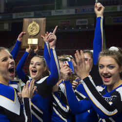 Hermon High School cheerleaders celebrate after winning the regional Class B North cheering competition at the Cross Insurance Center in Bangor on Saturday. 
