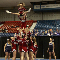 The Bangor High School cheering squad performs its routine during Saturday's Class A North title meet at the Augusta Civic Center. The Rams finished second.  