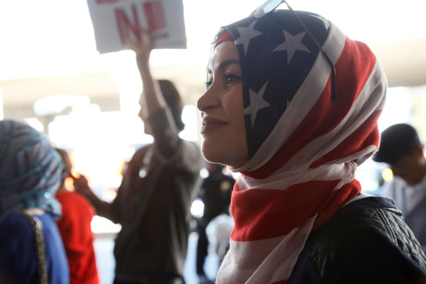 Kara Doufash is seen during a protest against the travel ban imposed by President Donald Trump's executive order at Los Angeles International Airport in Los Angeles. While Trump's order has outraged many, It is worth remembering that his actions are not an aberration in American immigration history.