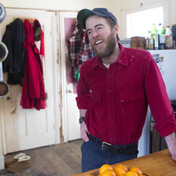 Young farmer Everett Ottinger, who is diabetic, talks about being able to afford medicine and doctor visits thanks to the Affordable Care Act Thursday at his farm, Nettie Fox Farm, in Newburgh.