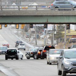 Traffic flows heavily on Broadway in Bangor and over the Interstate 95 overpass on Monday. City officials plan to mill and repave a section of the road from Center Street to Husson Avenue this year. Part of the road also was reworked in 2016.