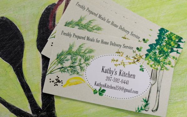 Business cards for Kathy's Kitchen, Kathy Flynn's business that involves preparing homemade meals to order, can be seen Friday at a commercial kitchen at the Thompson Community Center in Union.