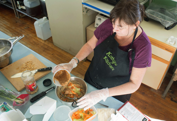 Kathy Flynn prepares homemade meals to order as part of her business, Kathy's Kitchen, Friday at a commercial kitchen at the Thompson Community Center in Union.