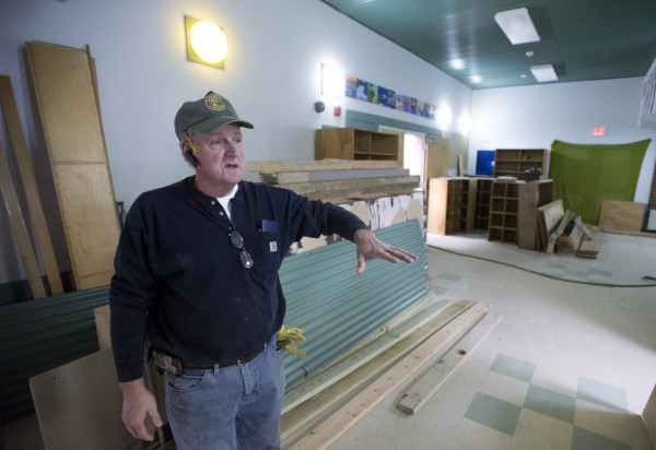 Jake Chambers, owner of Adult Family Care Homes of Maine, talks about building an assisted living facility that will be in the former Frankfort Elementary School while giving a tour of the building on Tuesday in Frankfort.