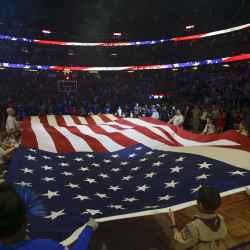 Boy Scouts of America hold the American Flag during the national anthem before the game between the Orlando Magic and the Memphis Grizzlies at Amway Center in Orlando, Florida, in this December 2016 file photo.