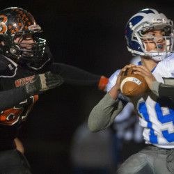 Brewer's Austin Lufkin (left) runs up to sack Lawrence's Braden Ballard during their Class B North quarterfinal at Doyle Field in Brewer in this October 2015 file photo.