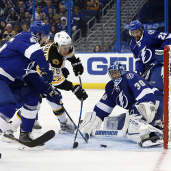 David Pastrnak of Boston (88) shoots on goal as Tampa Bay goalie Ben Bishop (30) makes a save during the third period of Tuesday night's NHL game at Amalie Arena. The Bruins beat the Lightning 4-3.