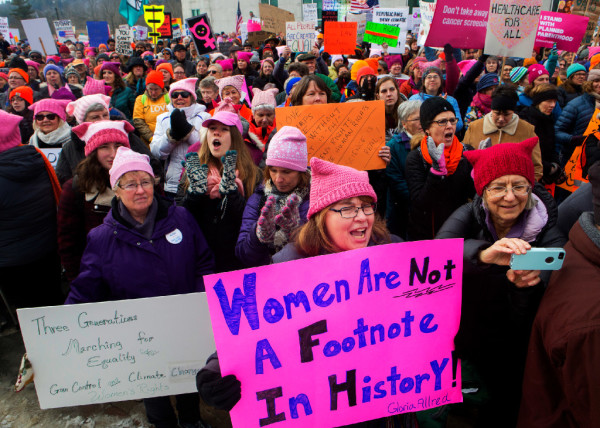 Michelle Robbins (center) cheers during the Women's March on Maine outside the Burton M. Cross building at the Maine State House in Augusta on Saturday. The national rally was in support of women's rights, civil liberties and protection of the planet.