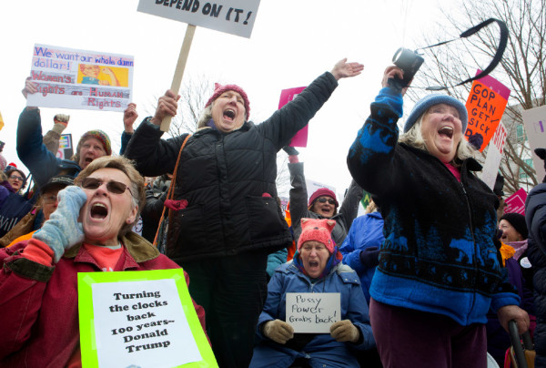 Margaret Zwicker (from left), Louise Ringle, Joan Shapleigh and Gayle LaVallee cheer during the Women's March on Maine outside the Burton M. Cross building at the Maine State House in Augusta on Saturday. The national rally was in support of women's rights, civil liberties and protection of the planet.