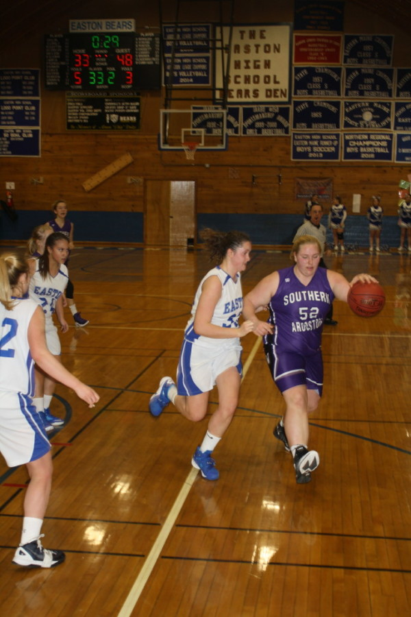 Southern Aroostook's Maddie Cummings (right) dribbles the ball against Easton's Elise Allen during their Class D North basketball game on Thursday in Easton.