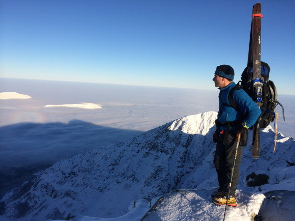 Dick Chasse, a senior guide for Acadia Mountain Guides Climbing School, stands atop Katahdin, Maine's tallest mountain, on Jan. 7, while camping and skiing for five days in Baxter State Park with his wife, Sarah O'Malley.