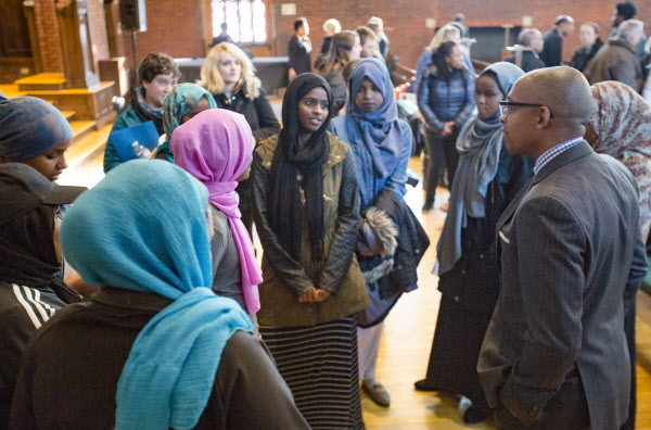 A high school racial inustice group goes up to meet Khalil Gibran Muhammed after his keynote address &quotNo Reparation without Racial Education: Martin Luther King on the Tyranny of Ignorance&quot for Bates College's &quotReparations: Addressing Racial Injustices&quot program at the Peter J. Gomes Chapel on campus in Lewiston on Martin Luther King Jr. day Monday morning.