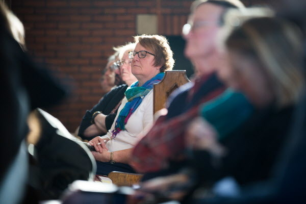 A woman closes her eyes as she listens to Khalil Gibran Muhammed give his keynote address &quotNo Reparation without Racial Education: Martin Luther King on the Tyranny of Ignorance&quot for Bates College's &quotReparations: Addressing Racial Injustices&quot program at the Peter J. Gomes Chapel on campus in Lewiston on Martin Luther King Jr. day Monday morning.