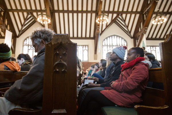 People listen as Khalil Gibran Muhammed gives his keynote address &quotNo Reparation without Racial Education: Martin Luther King on the Tyranny of Ignorance&quot for Bates College's &quotReparations: Addressing Racial Injustices&quot program at the Peter J. Gomes Chapel on campus in Lewiston on Martin Luther King Jr. day Monday morning.