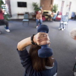 Kathy Zeman, 66, of Bucksport lifts a weight over her head during the Bone Builders class exercise at the The Heritage apartments in Brewer. The program is intended for area seniors to have a regular exercise routine.