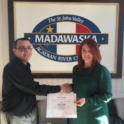Andrew Dube, Madawaska's Business Development Officer at left is congratulated by Suzie Paradis for achieving his certifications in code enforcement.