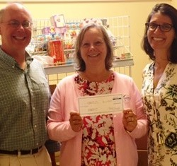 Left and right: Rob Benson and Jennifer Jones from the Bar Harbor Food Pantry receive a Community Commitment donation check from (center) Debbie Mitchell-Dow, AVP, Bar Harbor Branch Relationship Manager at Bar Harbor Bank & Trust.