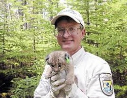 Mark McCullogh with a Canada Lynx kitten, one of his clients.