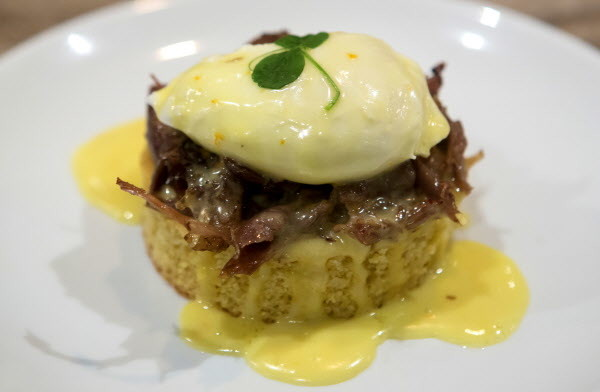 Duck confit eggs Benedict are seen at Novio's Bistro in Bangor.