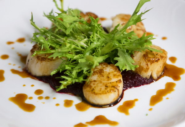 The sweet chili-sesame glaze scallops are seen at Novio's Bistro in Bangor.