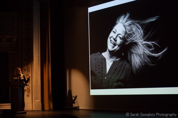 Photographer Erin Little at a past Pecha Kucha Night event.
