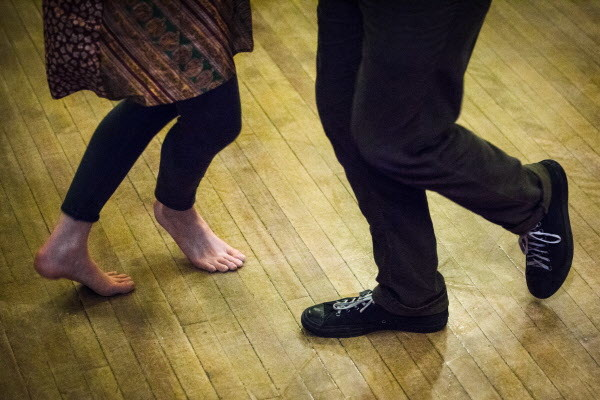 Dancers spin at the weekly Portland Intown Contra Dance on Thursday night at the State Street Church. After a 20 year break, contra dancing has come back to the city.