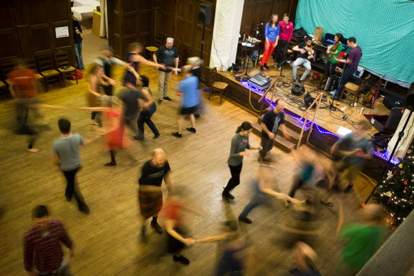 More than 50 dancers take to the floor at the Portland Intown Contra Dance on Thursday night. The weekly dance at the State Street Church started up in June.