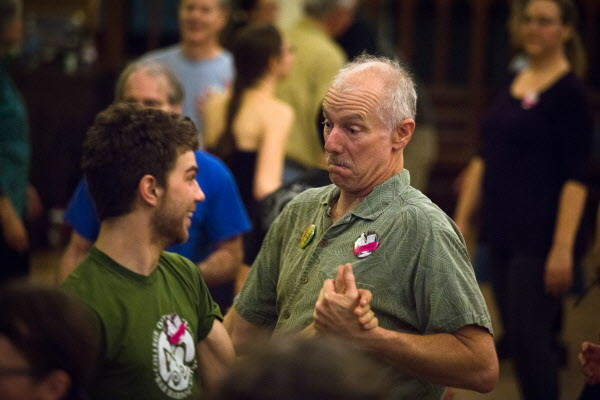 Xander Davenport (left) and Matthew Hight dance at the Portland Intown Contra Dance on Thursday night at the State Street Church. The weekly dance prides itself on being gender-free, where folks can dance either role.
