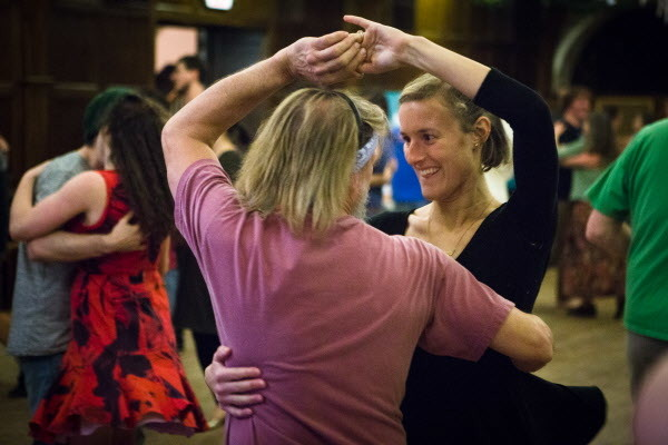 Caroline Suma dances with Tim Cason at the weekly Portland Intown Contra Dance on Thursday night at the State Street Church. Most contra dance figures combine a walking step and patterns repeating throughout dances.