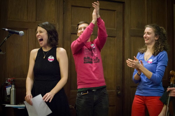 Founder Dela Taylor (from left) laughs while making announcements at intermission with co-founder Dugan Murphy and dance caller Gretchen Carroll at the Portland Intown Contra Dance on Thursday night at the State Street Church. Taylor and Murphy started the weekly dance in June.