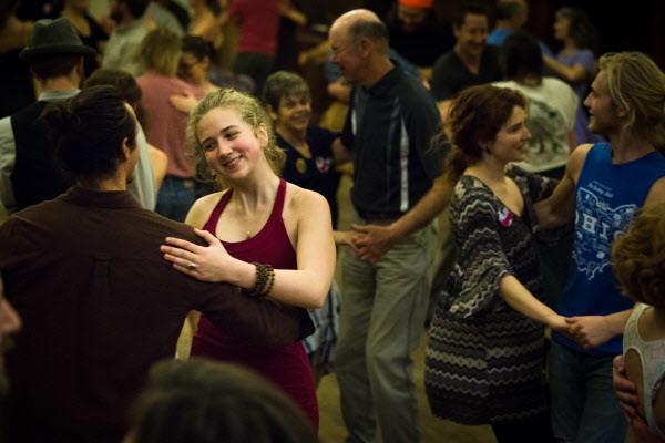 Reuben Begin (left) and Fiona Hall, along with a cast of dozens, dance at the weekly Portland Intown Contra Dance on Thursday night at the State Street Church.