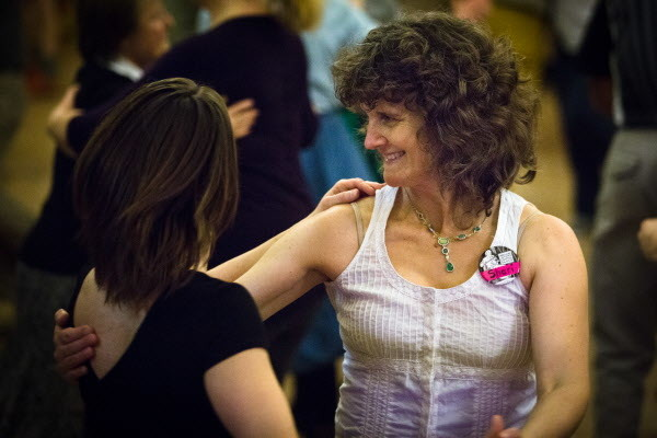 Shari Shakti dances with a partner at the Portland Intown Contra Dance on Thursday night at the State Street Church. The weekly dance prides itself on being gender-free, where folks can dance either role.