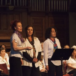 Manuela Brice (from left), Pam Koenig and Barbara Smith sing Billy Joel's 'Lullaby' during a Quoddy Voices show.