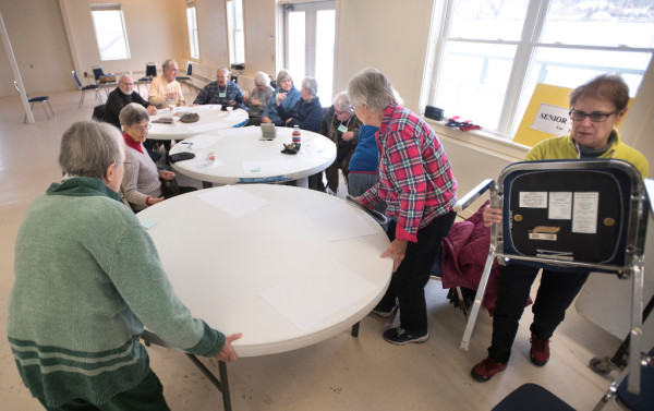 People pull tables together for the meeting of the Belfast Senior Center at the Belfast Boathouse on Tuesday. The participants of the group would like to have a permanent home for the Senior Center and have been discussing what people would like for activities. The city is allowing the use of The Boathouse through March of this year.